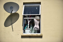Window And Satellite Dish Open...