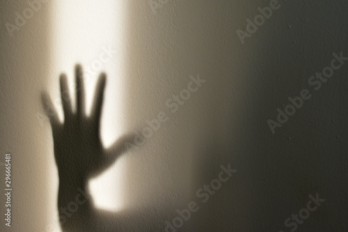 Fototapety, obrazy: Shadow of hand showing stop sign on the wall, halloween concept.