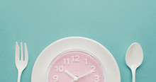 Pink Clock On White Plate, Int...