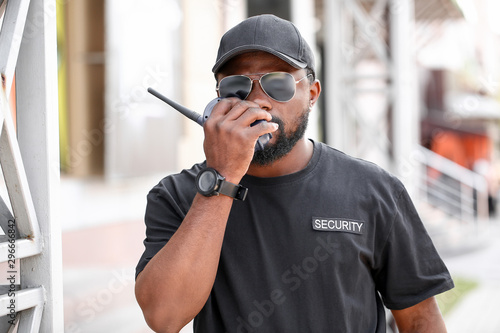 Leinwand Poster  African-American security guard outdoors