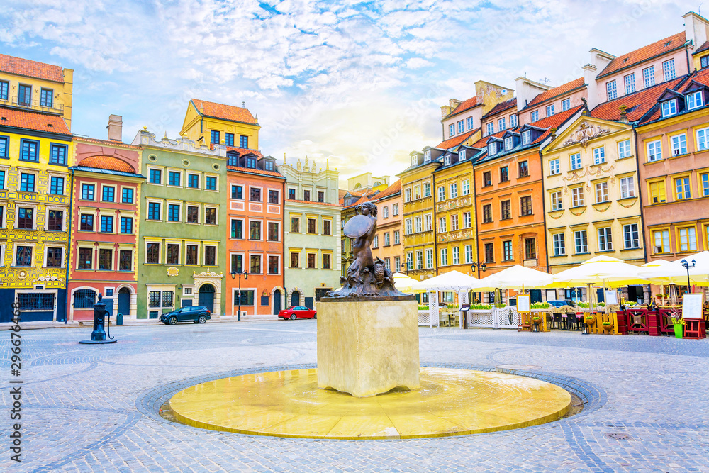 Fountain Mermaid and colorful houses on Old Town Market square in Warsaw, capital of Poland