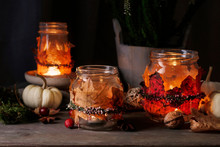 Autumn Lantern Jars Decorated With Colorful Leaves And Heather Wreath