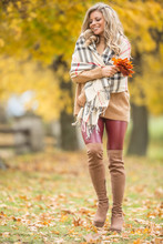 Young Woman In Autumn Outfit Emotional Walk In Park