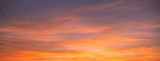 Sunset sky. Abstract nature background. Dramatic blue and orange, colorful clouds at twilight time.
