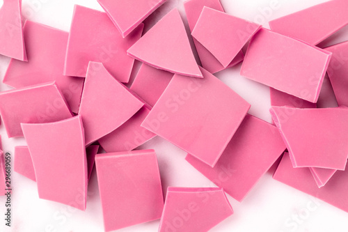 Ruby chocolate pieces, shot from the top on a white marble background - 296689059