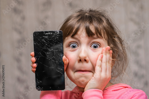 Photo The frightened child accidentally ruined the smartphone