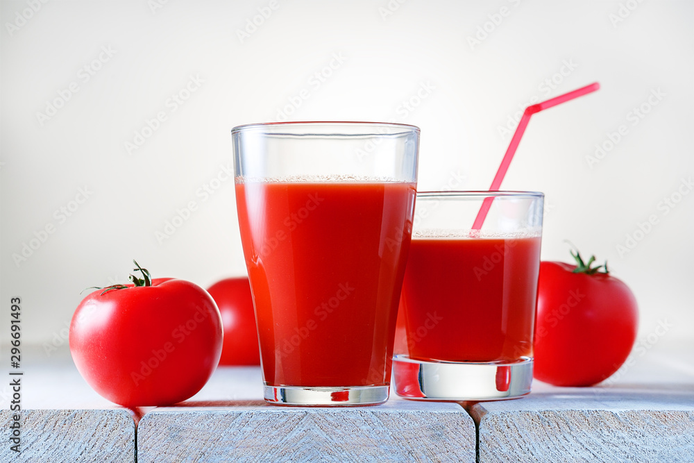 Fototapety, obrazy: Two glasses of fresh tomato juice on wooden table. Healthy food and drink.