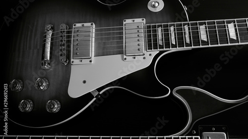 electric guitar closeup . dark background black and white Wallpaper Mural