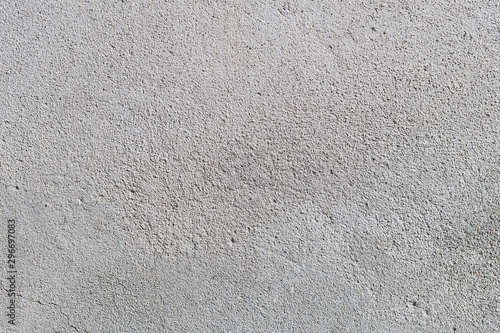 Fototapeta Gray textured cement wall background with fine concrete chips. Construction backgrounds obraz