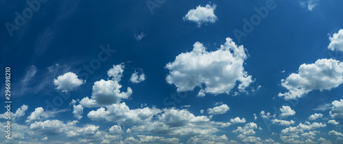 Some light cumuliform clouds in the clean blue sky. Фотошпалери