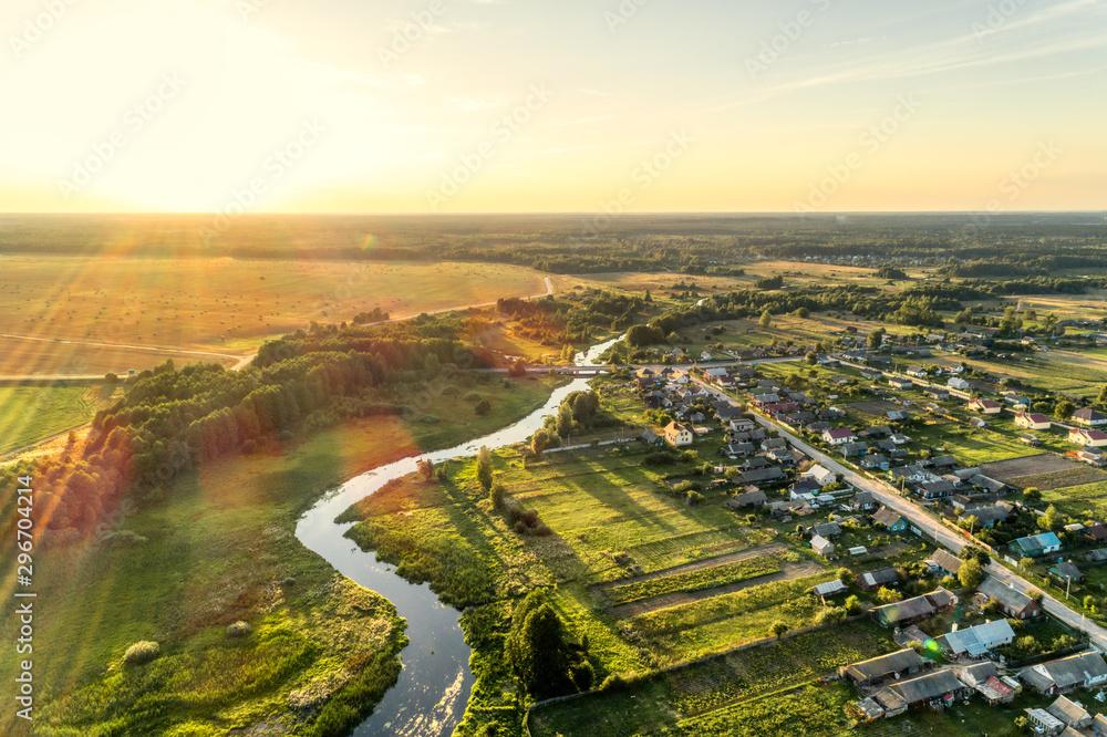 Fototapeta Aerial view. Small european village. Blue winding river.