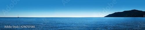 ocean panorama island and sailboat
