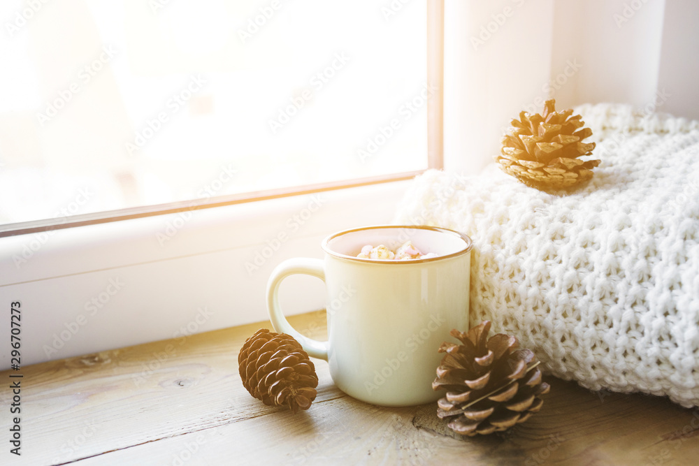 Fototapety, obrazy: Cones and hot chocolate near scarf and window