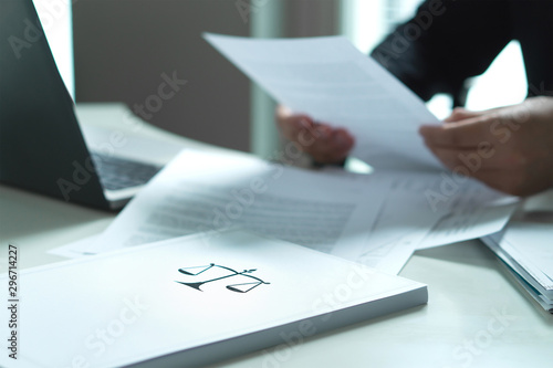 Photo Man holding a legal document in hand