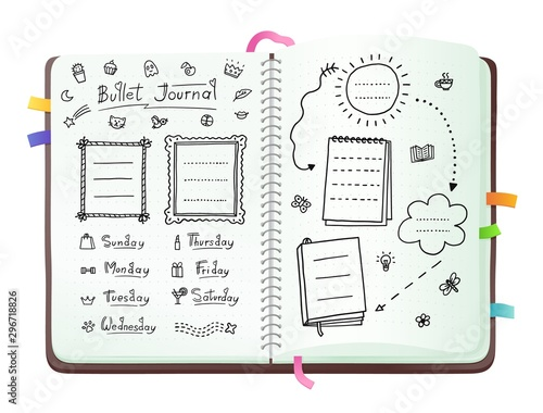 Fotografía Bullet journal pages with doodle drawings and week layout