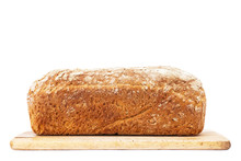 Loaf Of Bread On Cutting Board Isolated On White