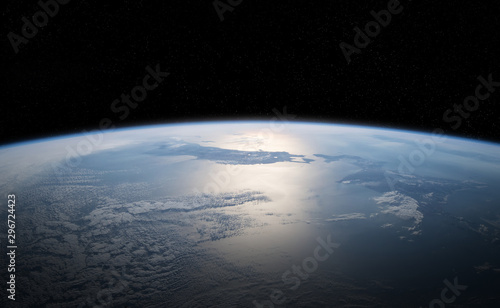 Fotografia, Obraz View of planet Earth close up with atmosphere during a sunrise 3D rendering elem