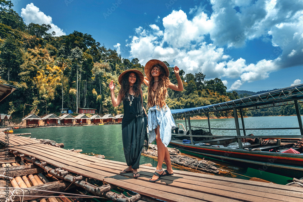 Fototapety, obrazy: Two beautiful cheerful girls with vietnamese hats on tropical background