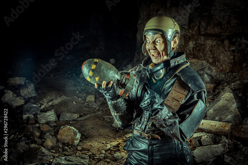 Soldier woman with the bomb on post apocalyptic background. Canvas-taulu