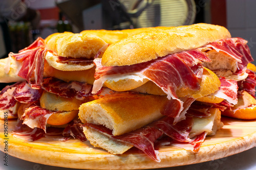Spanish street food bocadillo fresh bread with jamon iberico ready to eat Canvas