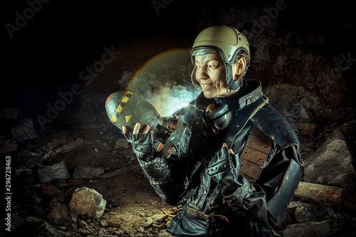 Fotografie, Obraz Soldier woman with the bomb on post apocalyptic background.