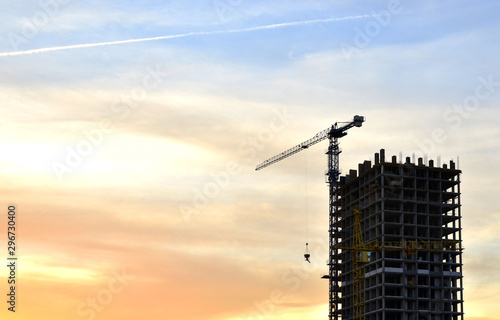 Jib construction tower crane and new residential buildings at a construction sit Obraz na płótnie
