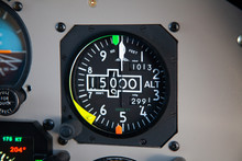 Altimeter In An Airplane Cockp...