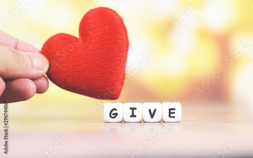 Fotografie, Obraz Give love with red heart in hand for donate and philanthropy health care love or