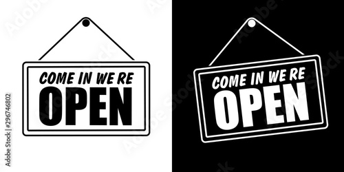 Fotografía  Come in we're open in signboard with a rope. Vector