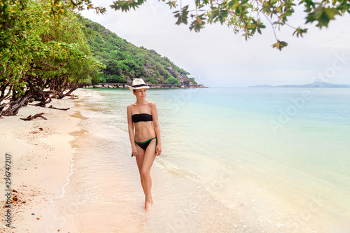 Young woman walking on a beach in Thailand Canvas Print