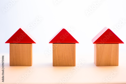three wooden block houses abreast Canvas Print
