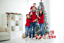 Full Body Photo Of Big Full Lovely Family Of Schoolgirl Cuddle Her Daddy Carry Younger Child And Mommy Celebrate Christmas Time X-mas Holidays In House With Gifts Indoors