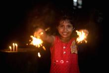 A Little Girl With Sparkler Celebrating Diwali/christmas