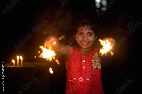 A little girl with sparkler celebrating diwali/christmas Tapéta, Fotótapéta