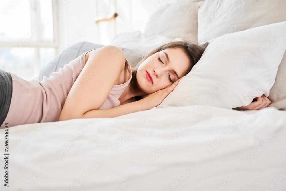 Fototapeta Image of young girl sleeping on bed.