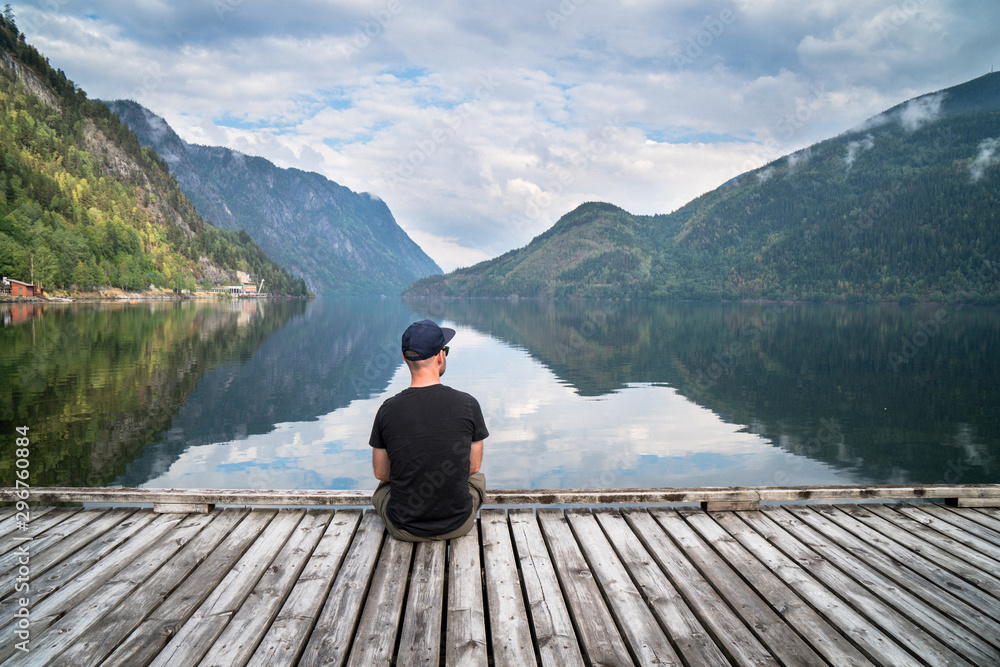 Fototapeta man looking on the lake and fjords
