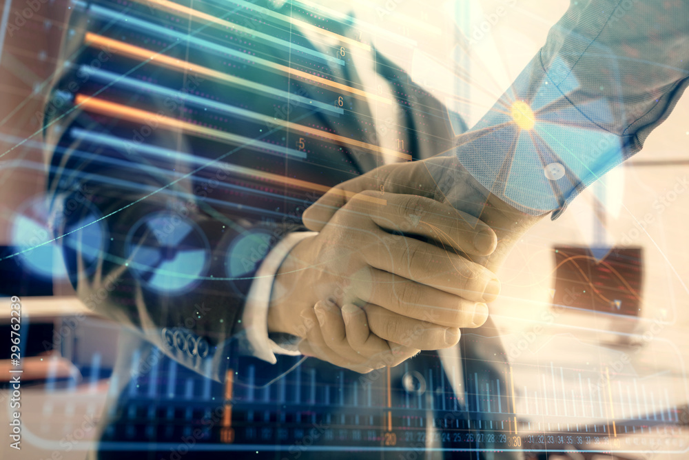 Fototapeta Double exposure of business theme drawing on office background with two businessmen handshake. Concept business