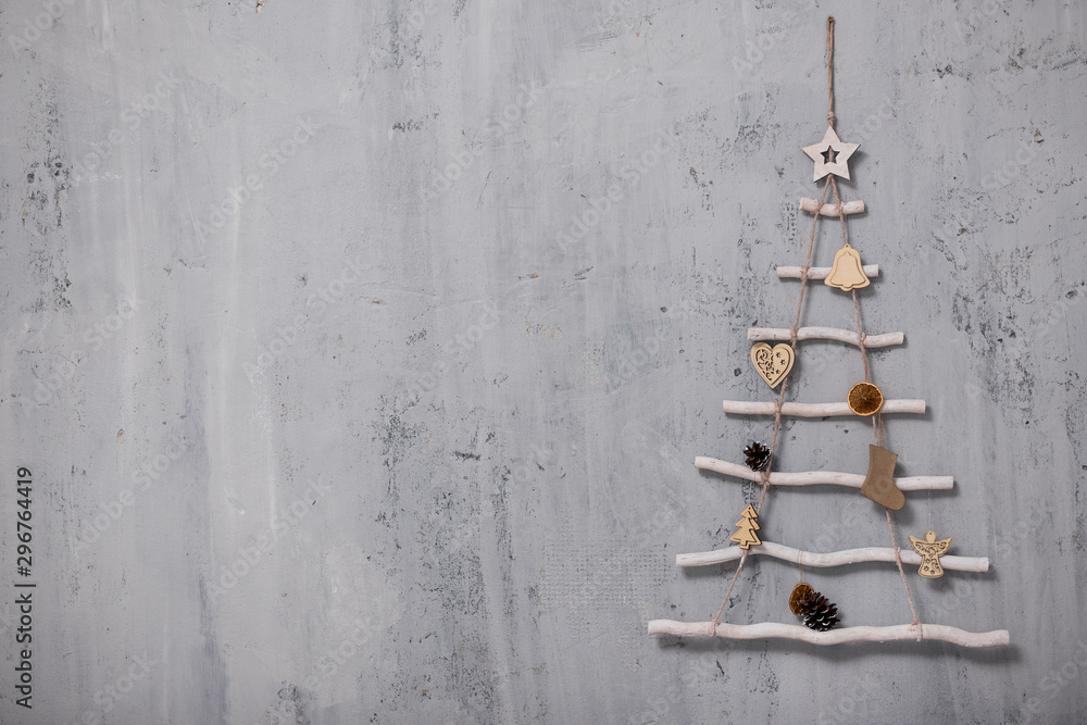 Fototapety, obrazy: artificial christmas tree and copy space over grey concrete wall