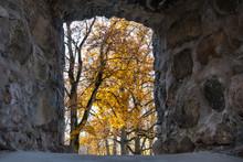Window In Stone Wall In Autumn...