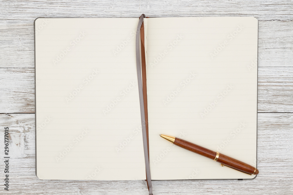 Fototapeta Blank brown journal with pen on a weathered whitewash wood background