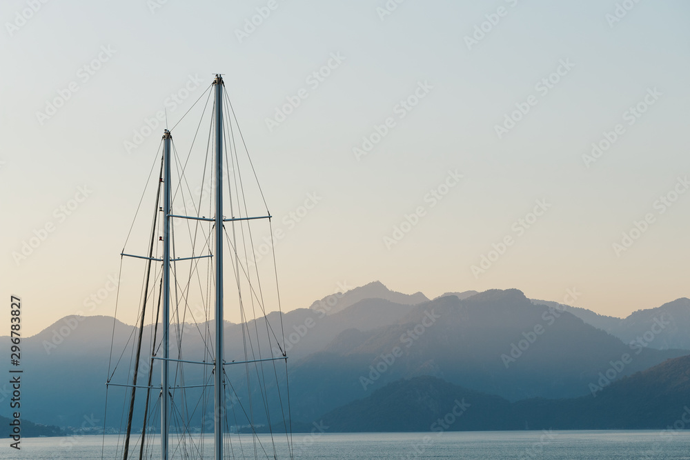 Fototapety, obrazy: Ship mast on a background of blue sunset sky and mountains.