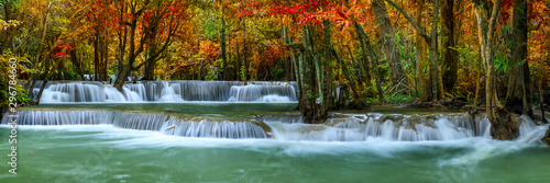 Poster Cascades Colorful majestic waterfall in national park forest during autumn, panorama - Image