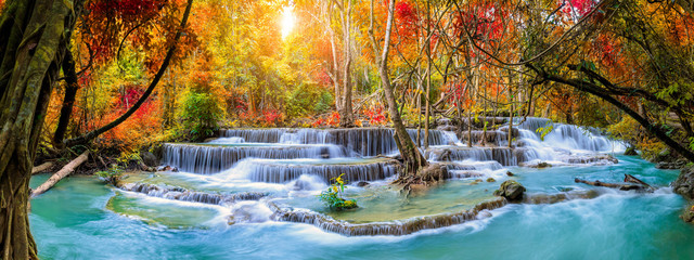 Colorful majestic waterfall in national park forest during autumn, panorama -...