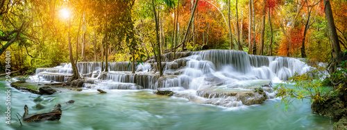 Wall Murals Waterfalls Colorful majestic waterfall in national park forest during autumn, panorama - Image