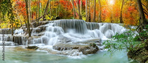 Obraz na ścianę wodospad   colorful-majestic-waterfall-in-national-park-forest-during-autumn-panorama-image