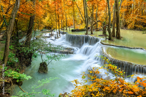 Photo sur Toile Pistache Colorful majestic waterfall in national park forest during autumn - Image