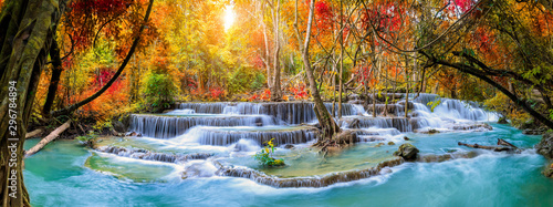 Wall Murals Forest river Colorful majestic waterfall in national park forest during autumn, panorama - Image