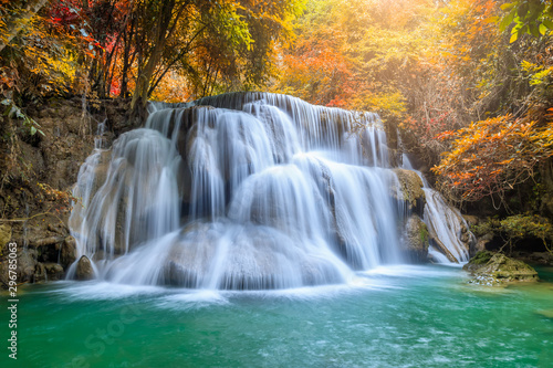 Fototapety, obrazy: Beautiful and colorful waterfall in deep forest during idyllic autumn
