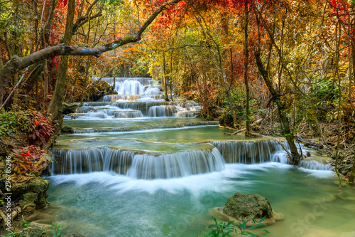 Fond de hotte en verre imprimé Cascades Beautiful and colorful waterfall in deep forest during idyllic autumn