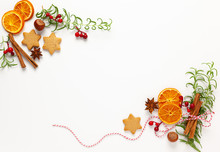Christmas Composition With Cookies, Dried Oranges, Cinnamon Sticks And Herbs On White Background. Natural Food Ingredient For Cooking Or Christmas Decor For Home. Flat Lay.